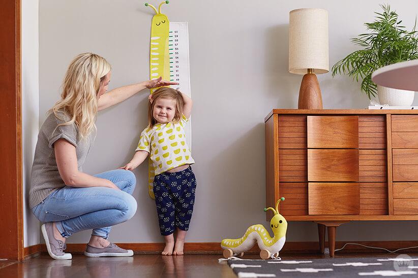Hallmark Artist Amber G measures daughter. Hallmark Baby Cute Critters collection