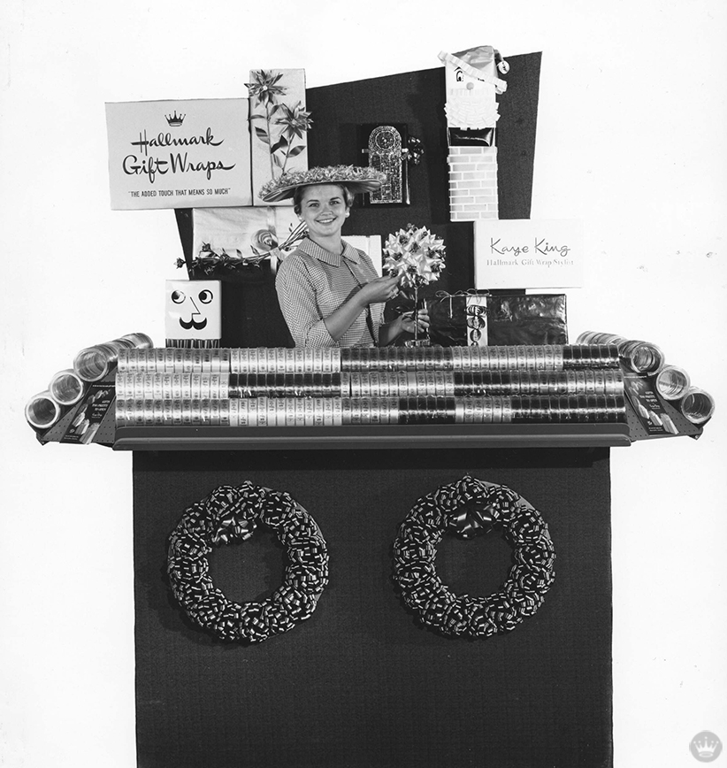 "From our gift wrap history: Stylist ""Kaye King"" poses with her pop-up Hallmark Gift Wraps booth, c. 1956"