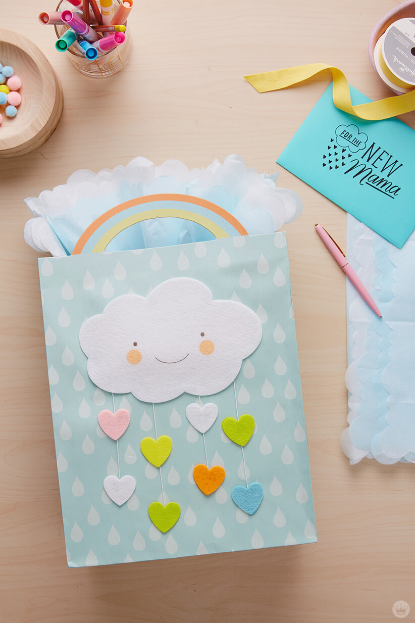 Dreamy baby gift wrap ideas: Fan-fold your tissue paper.
