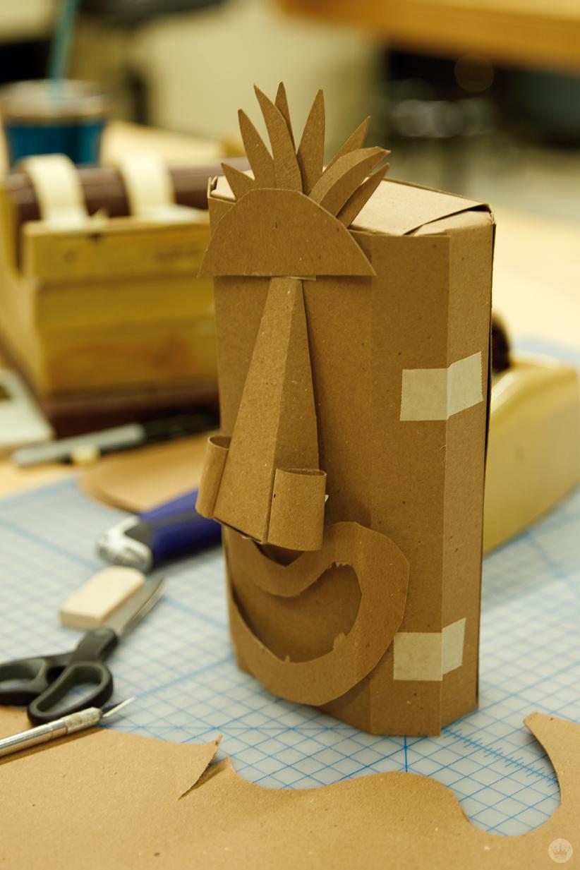 Hallmark artists explore cardboard Halloween costume ideas. Tiki mask.