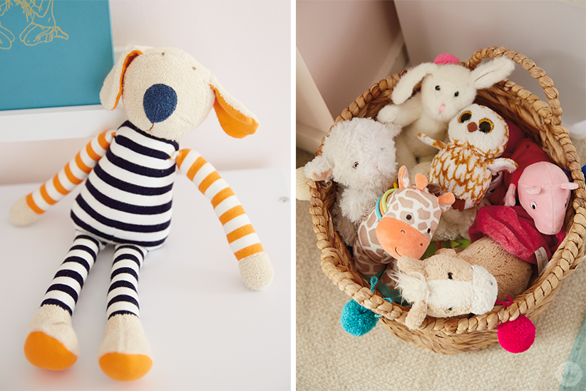 Stuffed animals sit on display and fill a basket decorated with pom-poms.