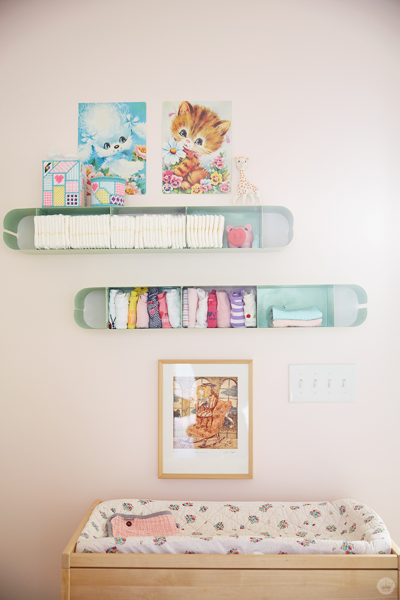 CD cases are used to hold diapers and onesies over a changing table.