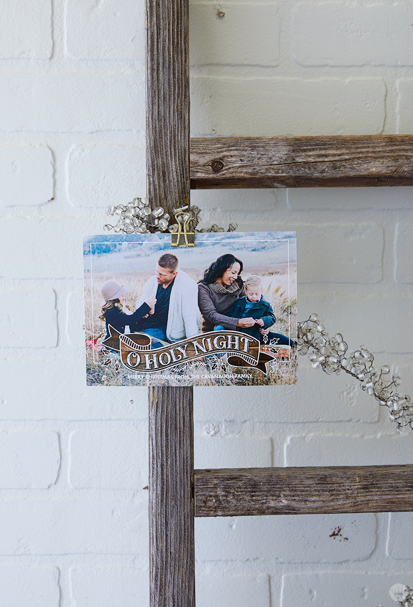 A card attached to the Wooden Ladder Christmas Card Display