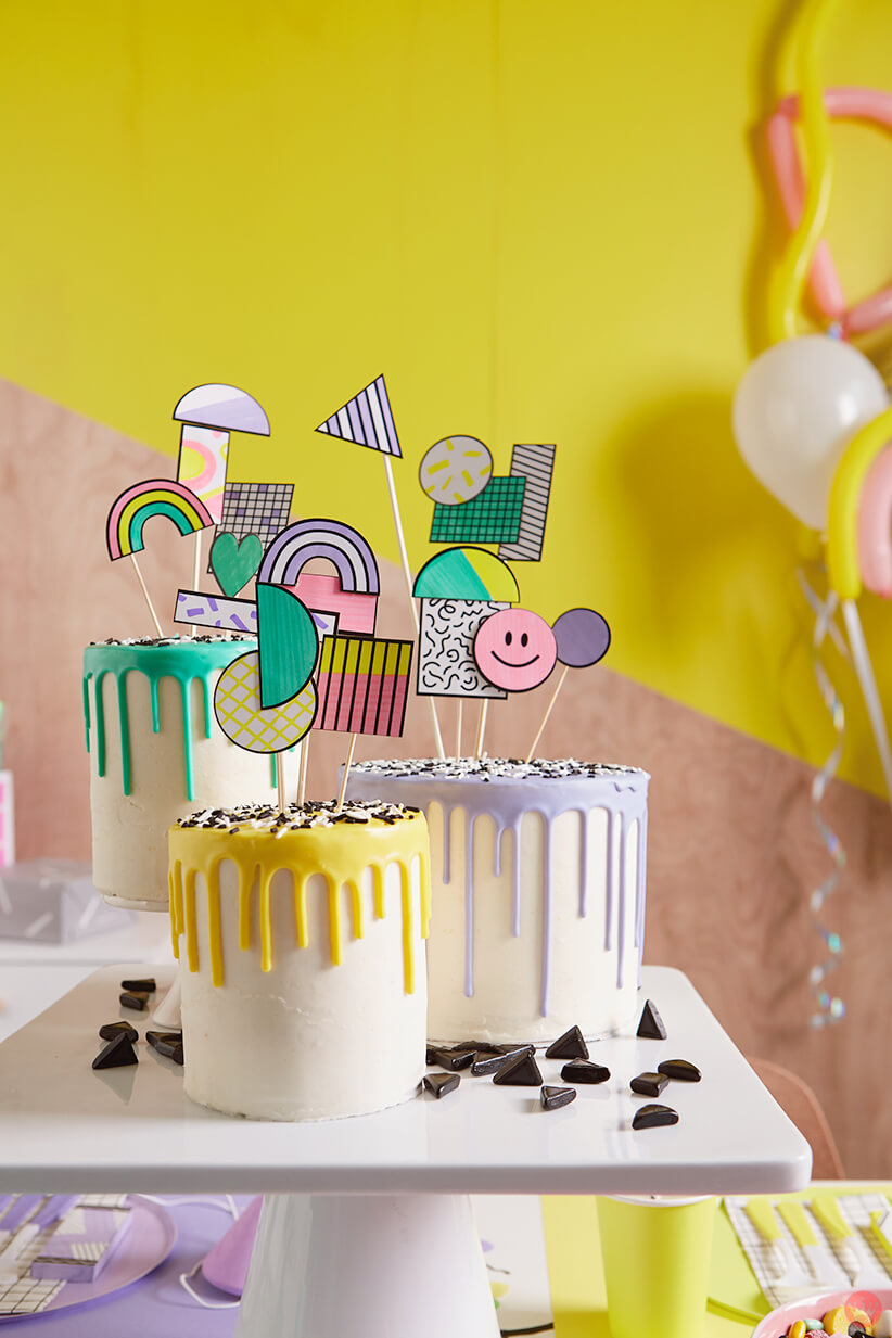 Retro cake toppers on a drip cake