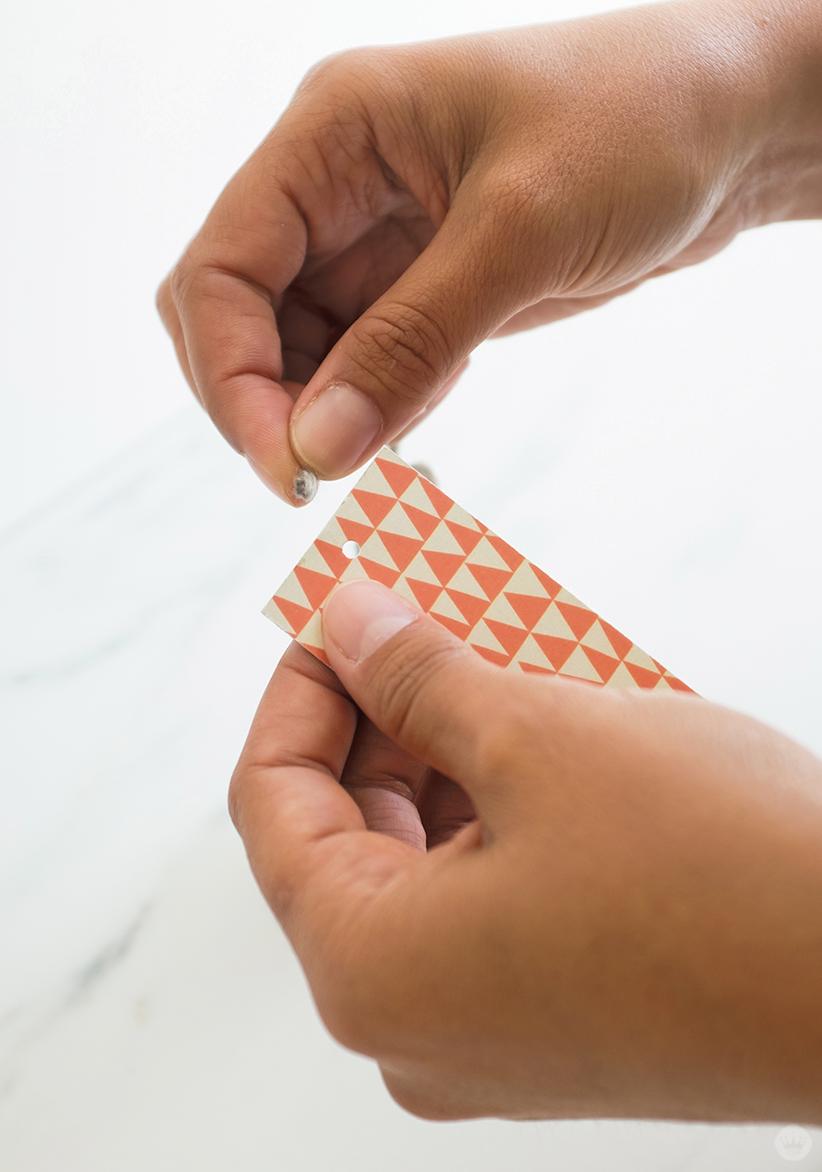 DIY Tassel Bookmarks: Inserting yarn through hole in bookmark