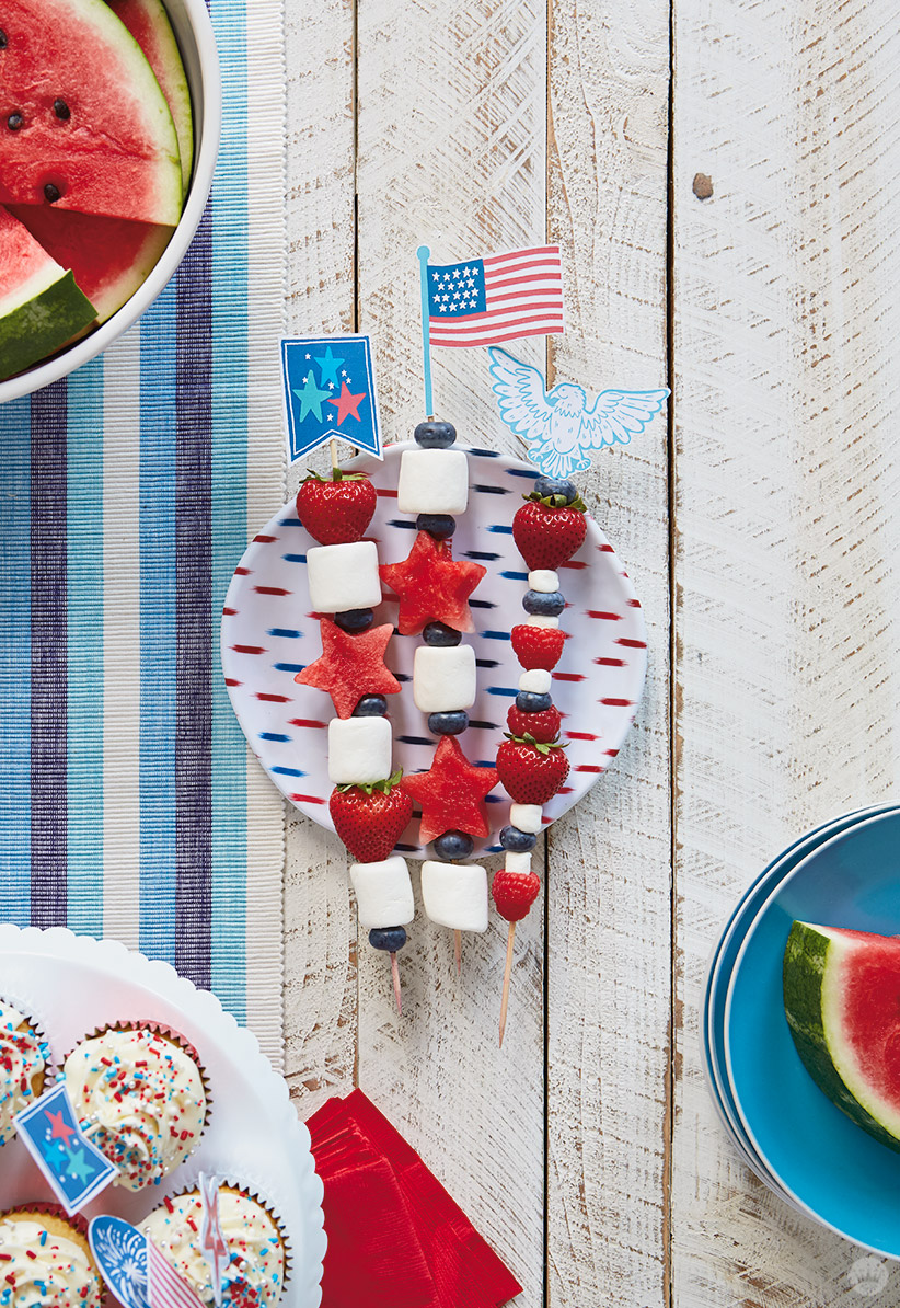 Fruit and marshmallow kabobs with patriotic toppers.