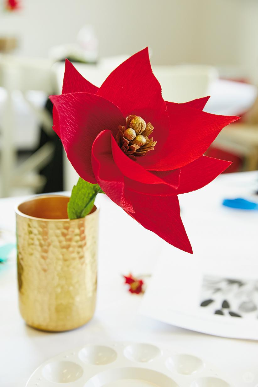 DIY paper poinsettia in a brass vase