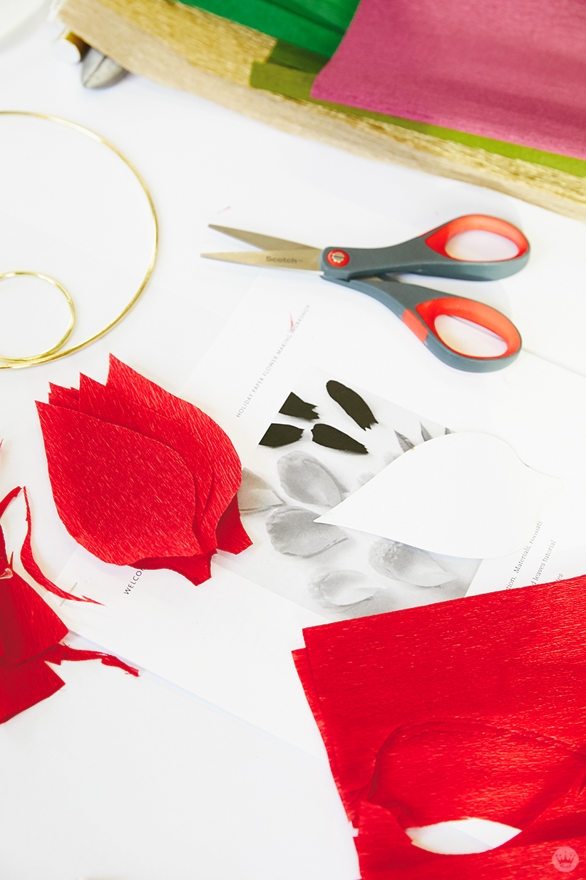 Supplies for a DIY paper poinsettia wreath or gift tag