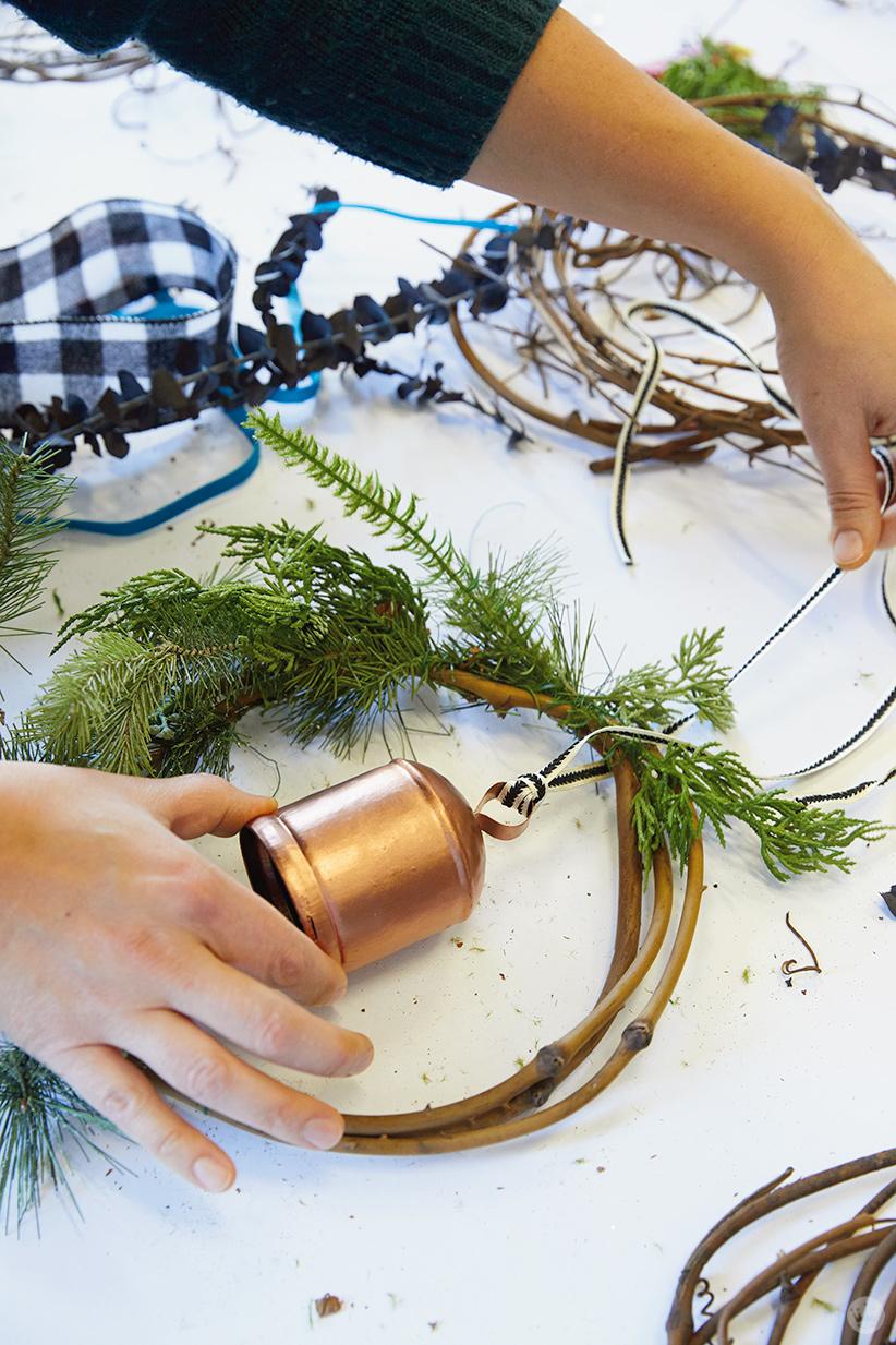 Modern Christmas wreath ideas: Adding a bell to a grapevine wreath