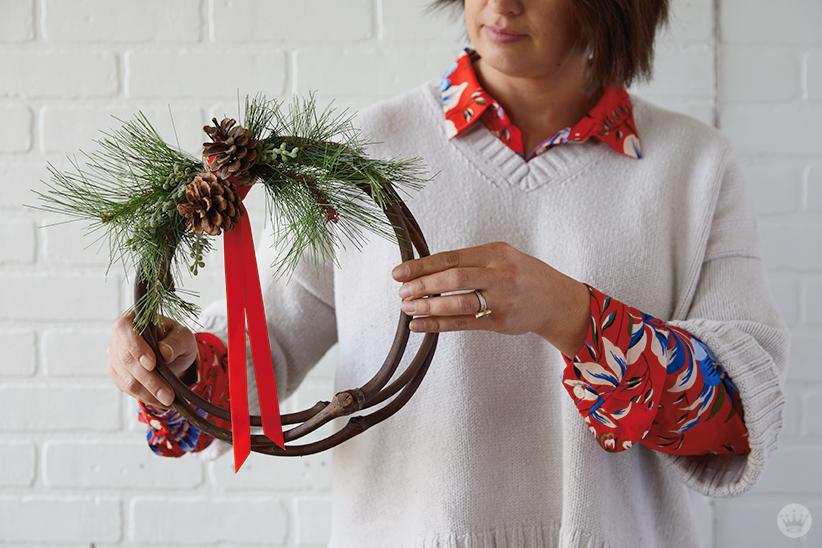 Modern Christmas wreath ideas: Asymmetrical wreath with pine greenery