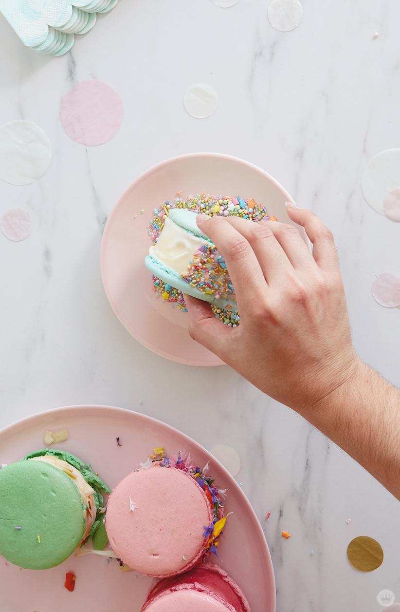 Rolling ice cream sandwich in fancy sprinkles