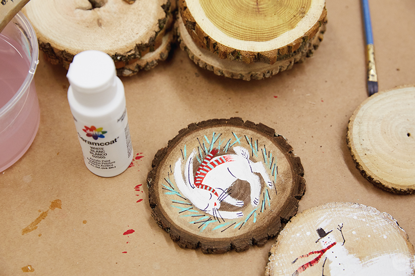 DIY ornament ideas: Hand-painted bunny and snowman on wood rounds