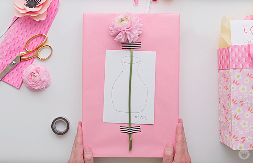 Hand-drawn vase on a Mother's Day card, attached to the gift with a flower and washi tape.