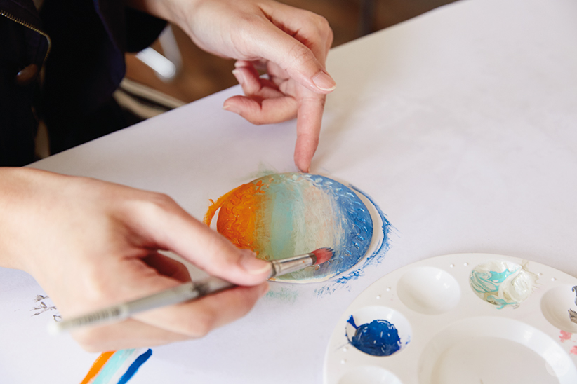 Painting clay polymer night lights with water-based acrylic paint.