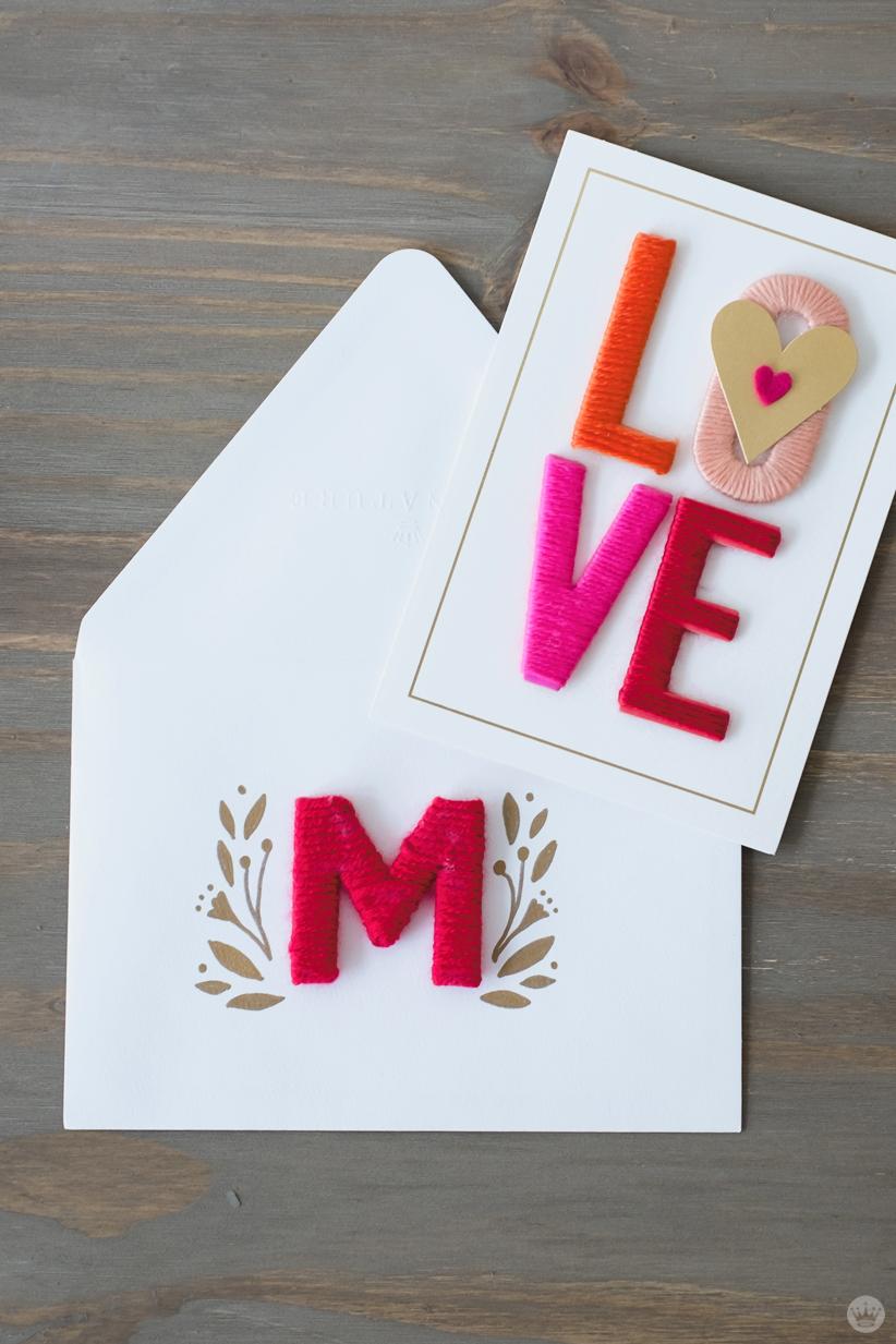 DIY Valentine's Day envelope art: yarn-wrapped monogram