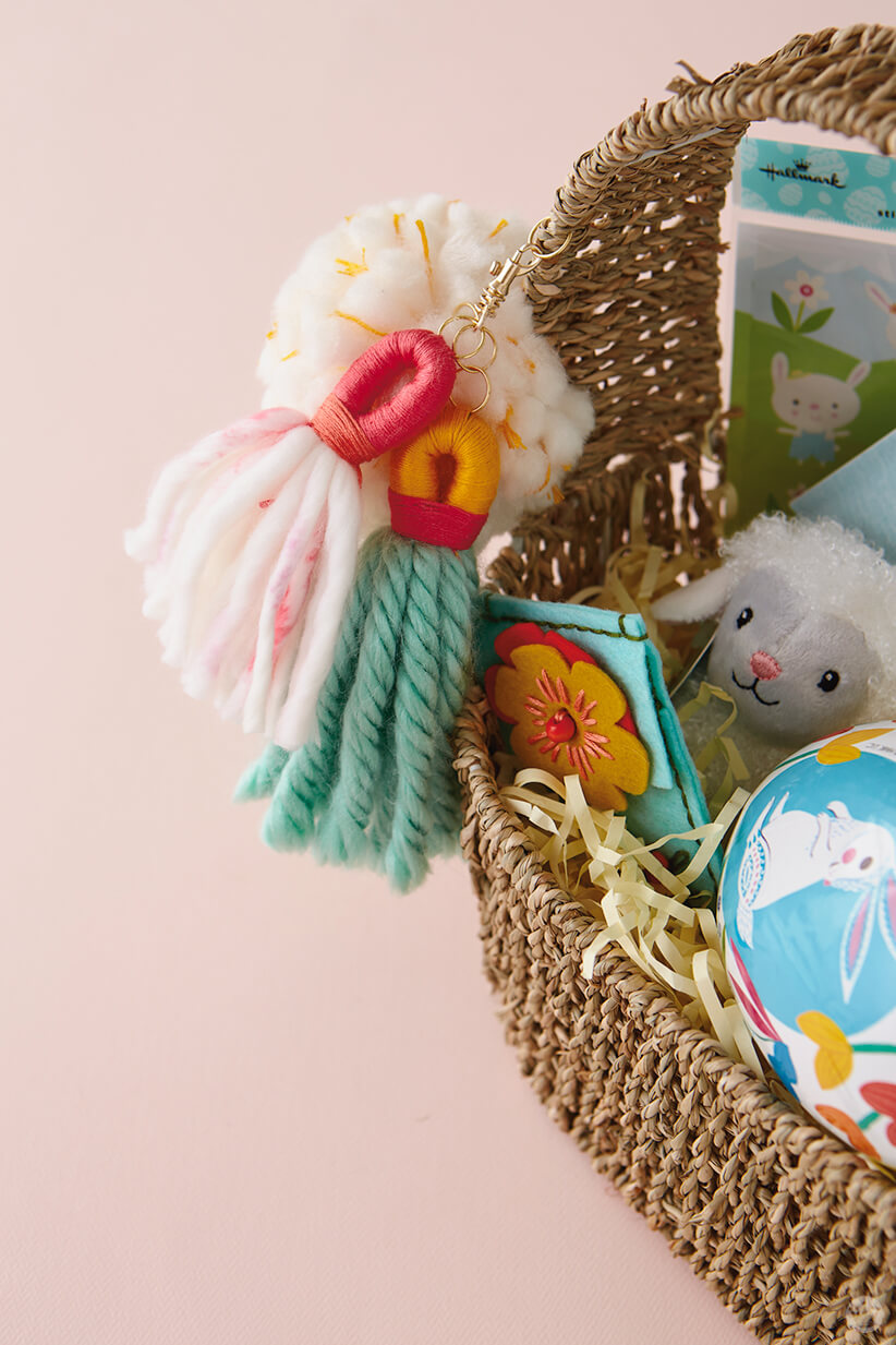 DIY Chunky Yarn Keychain attached to an Easter basket