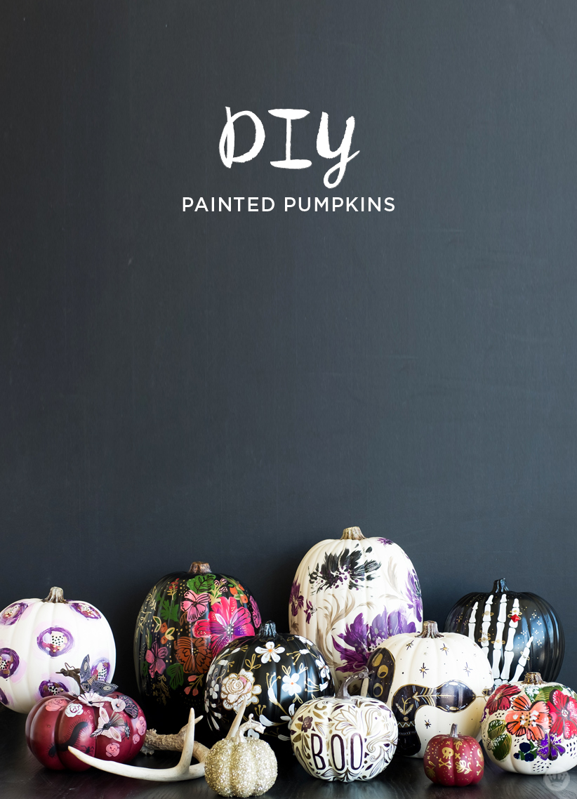 Elegant Halloween pumpkins: Black, white, and red pumpkins painted in different designs.
