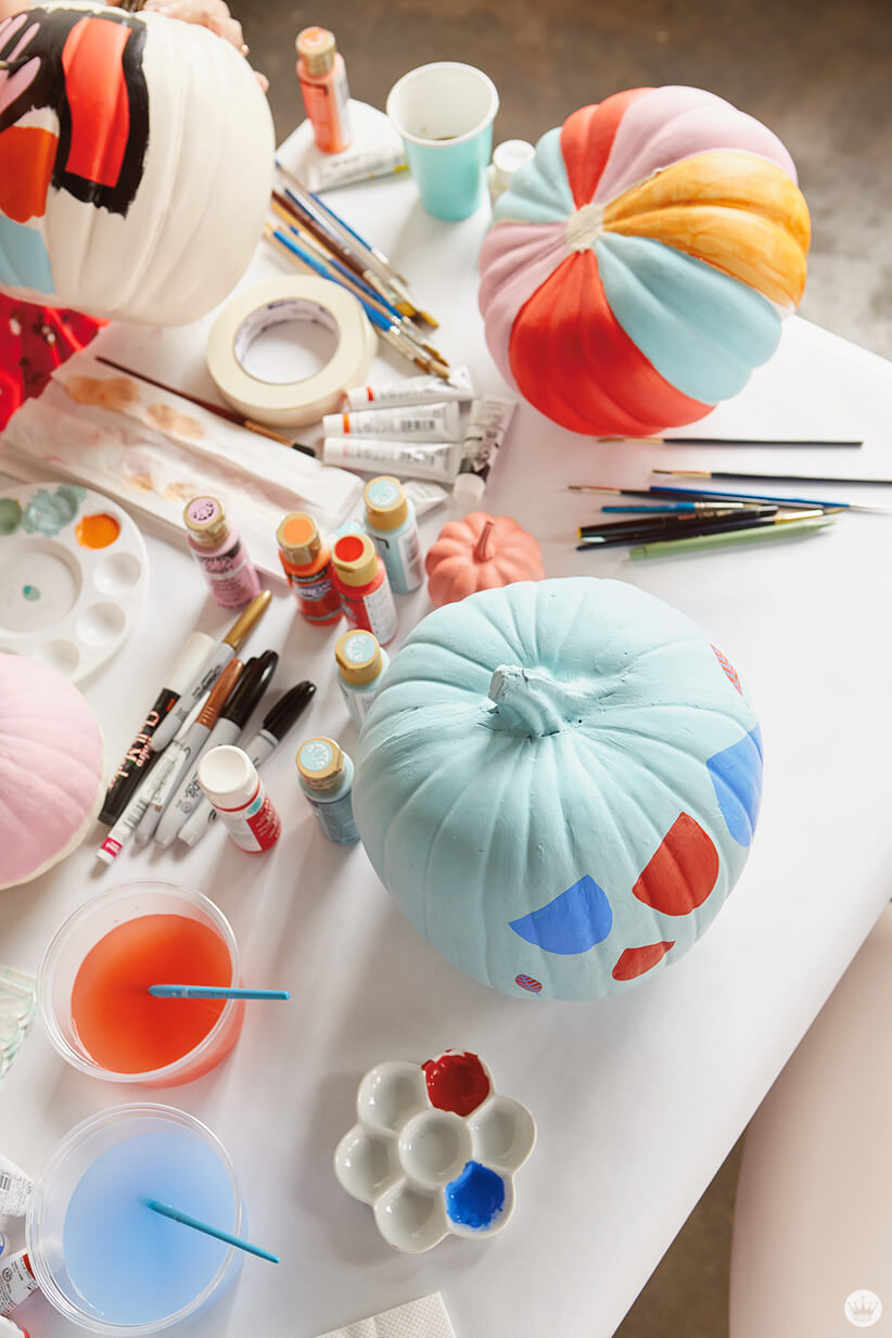 Painting supplies and painted pumpkins