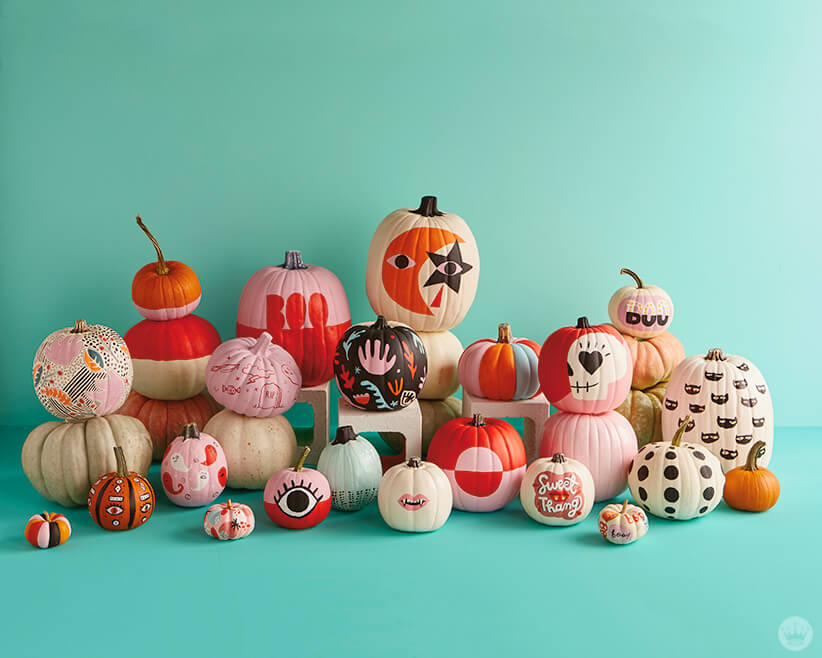 Display of painted pumpkins in various sizes and shapes