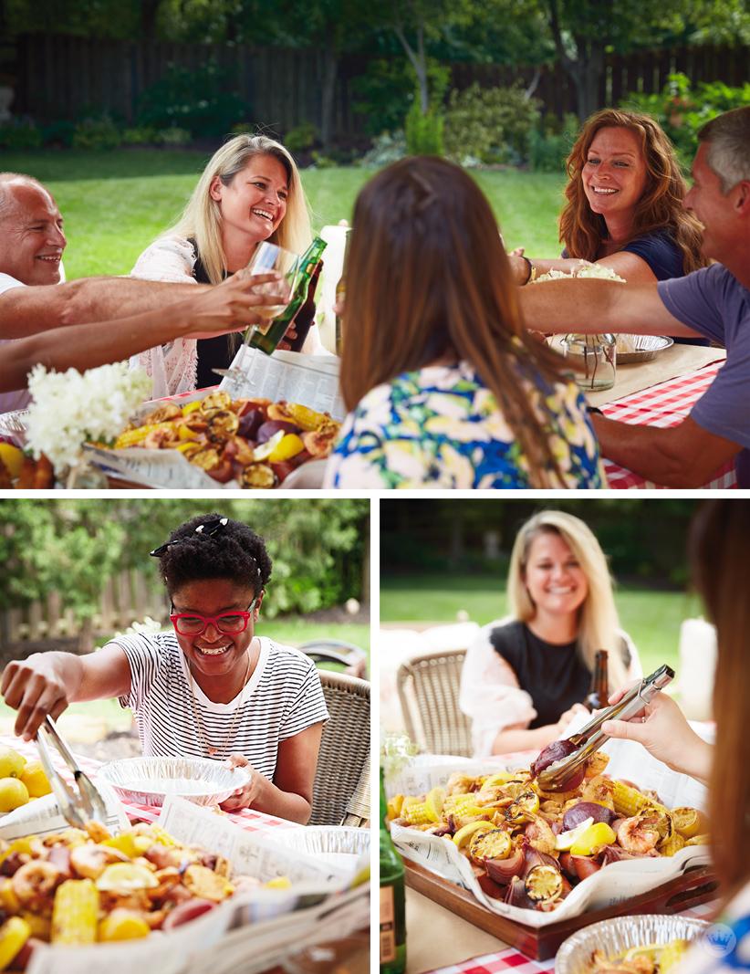 People eating at a shrimp boil picnic