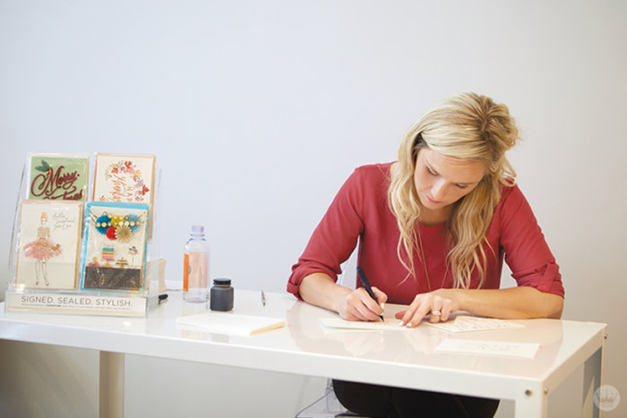 Hallmark Lettering Artist Amber G. addresses envelopes at the new Hallmark Signature Store in Santa Monica, CA