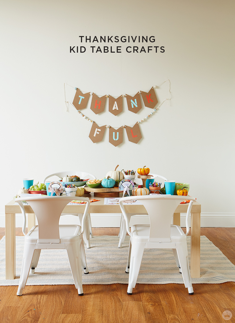 "thanksgiving kids' table crafts: Kids table set with activities and ""thankful"" garland"