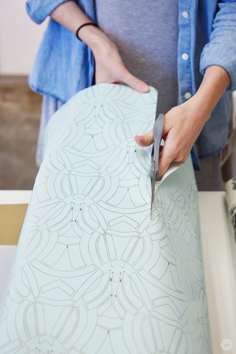 Cutting giftwrap from Hallmark's Classic Luxury collection.