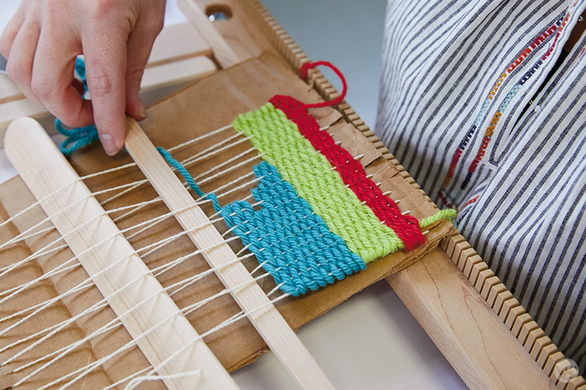 Weaving workshop: hallmark artists learn to weave on cardboard looms
